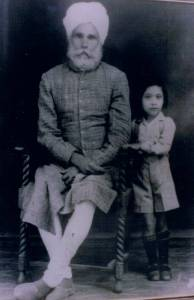 1. Jawala Singh with his grandson Ravinder Ravi- Sialkot, Pakistan - 1943 - Studio photo by Nanak Chand photographers.