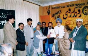 1.   Ravinder Ravi receiving Life Time Achievement Award from Raja Rasaloo & Afzal Tauseef - Lahore,Pakistan - Jan 22, 2006