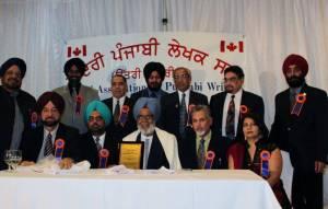 11. Ravinder Ravi receiving Life Time Achievement Award from Kendari Punjabi Lekhak Sabha(North America) - Surrey, BC, Canada - 2011 - Pic. by the Sabha photographer(FILEminimizer)