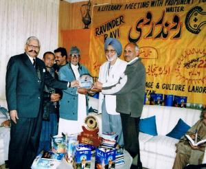 2.  Ravinder Ravi receiving Pride of Performance Award from Ameen Khyal & Iqbal Kaiser - Lahore, Pakistan, January 22, 2006