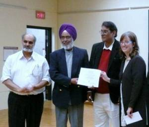 2. UBC Life Time Achievement Award-2011 for Ravinder Ravi - Dr. Anne Murphy is presenting Award to Ravi Sukhwant Hundal & Gurumel are also seen in th(FILEminimizer)