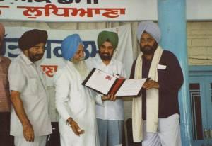 4. Ravi receiving Kartar Singh Dhaliwal Award - Dr. Parminder Singh, Giani Lal Singh, Dr. S.S.Johal(VC) & Ravinder Ravi - Punjabi Bhavan, Ludhiana, I