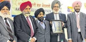 5. Ravi receiving Life Time Achievement Award from Arpan Likhari Sabha - Dr. Raghbir Sirjana, MLA Darshan S. Kang, Satnam Dhah, Ravinder Ravi & Sukhd(FILEminimizer)