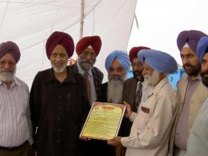 7. Ravi being honored by Likhari Sabha, Jagat Pur - 2006 - Gulzar Sandhu, Dr. Atamjit, Mohinder Dosanjh, Balihar Randhawa, Gurbhajan Gill & Inderjit Hassan Puri can be seen in the picture